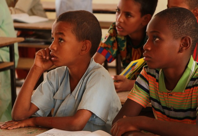 Mohamed Moussa, Almoustapha Moussa (brothers) and Mohamed Almoustapha listen to a lesson about time.  As you can tell there are not too many name variations.  One quarter of the class is named Mohamed.