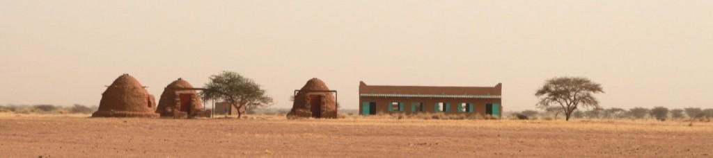 Teacher's residence left, girls dorm, boys dorm and school.