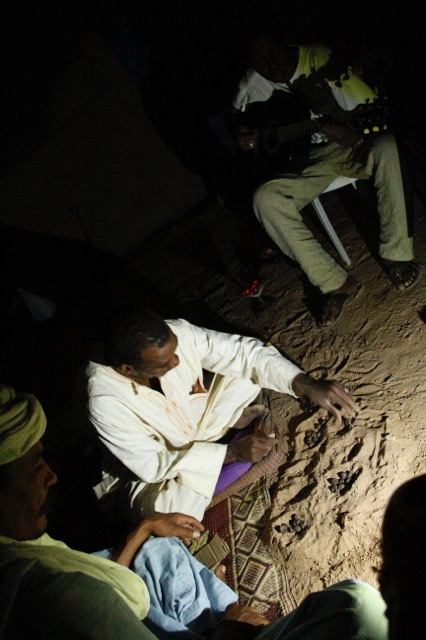 Back at Tamesna a highly contested camel dung game accompanied by Alhassane on the guitar.