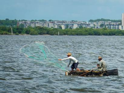 Men Fishing in Cuba on a Make-shift Boat