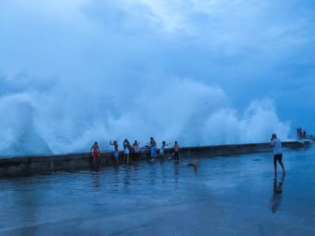 Children Playing with Storm Surf on Havana's Malecon