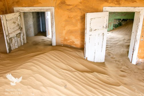 Sand Dunes Flowing through a House, Komanskop Ghost Town, Namibia