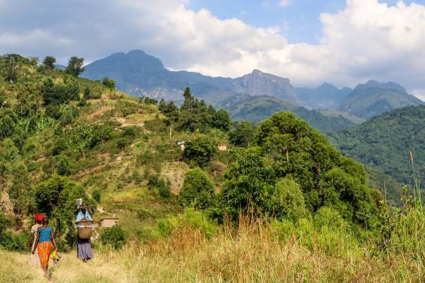 Trekking Through Villages with The Gateway to the Rwenzori Mountains in the Background