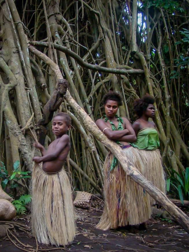 Young Girl Fastens her Grass Skirt, Tanna Island, Vanuatu