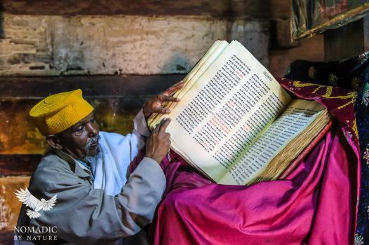 A Drunken Monk Taking us through his Bible, Debre Damo, Ethiopia