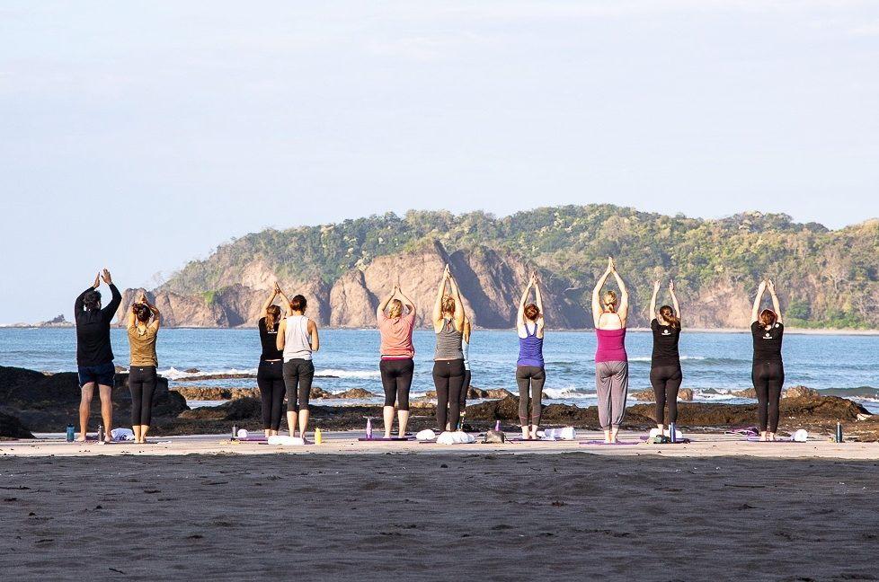 G Adventures tour group doing yoga in Costa Rica