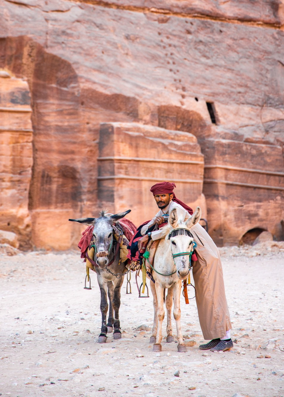 Bedouin and his donkey in Petra, Jordan