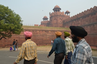 A group of Sikh men saunter towards the Red Fort.