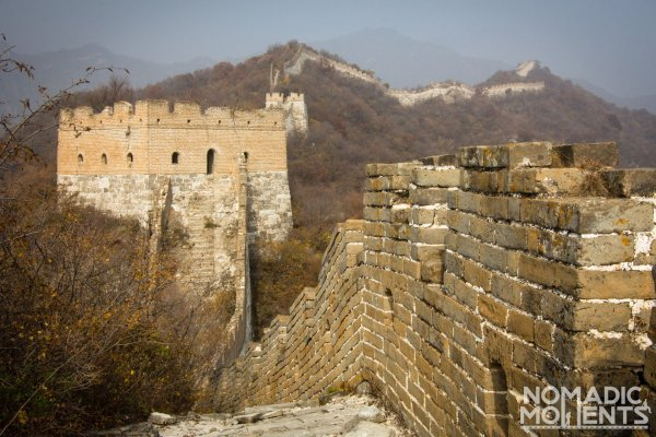 The Unrestored Section of The Great Wall runs into the distance along the ridge of the mountains.