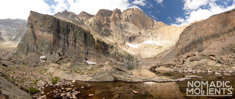 A mountain peak rises out of a small lake.