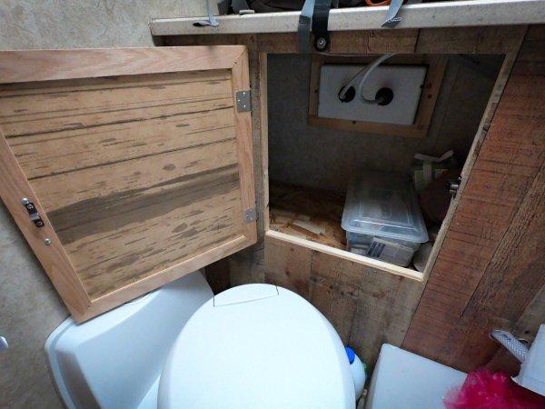 The bathroom area's storage access door.