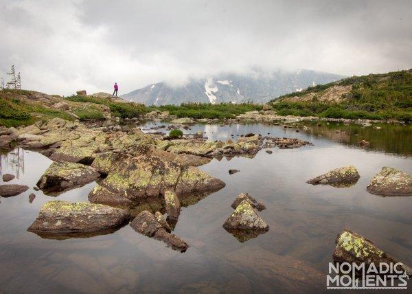 Hiker Overlooks Lion Lake