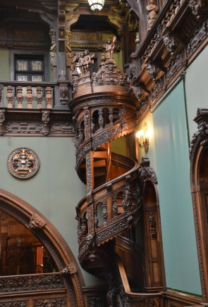 Spiral staircase in the Hall of Honour at Peleș Castle in Sinaia, Romania