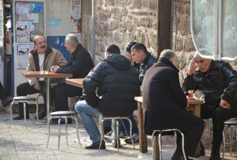 Men chatting over a glass of çay in Üsküdar, Istanbul, Turkey