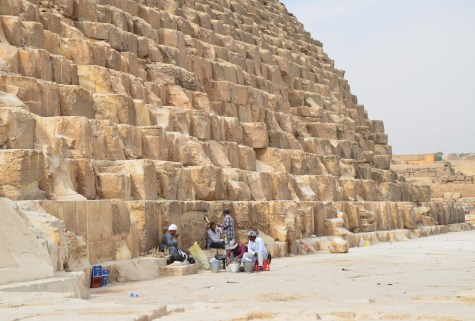 Vendors resting at the Pyramid of Khufu at the Pyramids of Giza in Egypt