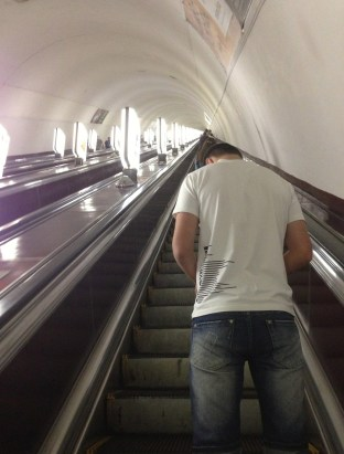 If you ride the Metro, take a book. The escalators are long. in Kiev, Ukraine