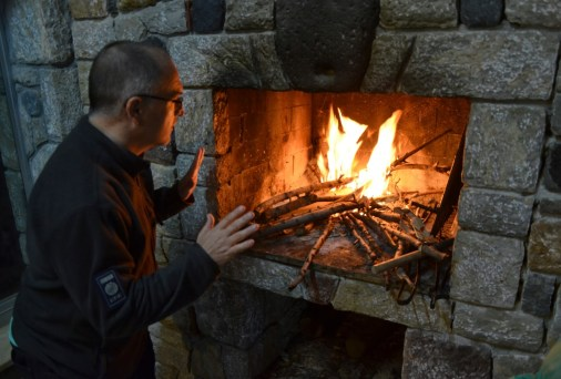 Martin warming up by the fire at Ovabükü, Datça, Turkey