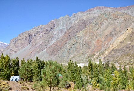 The changing colors of the mountain near the end of the day at El Morado, Cajón del Maipo, Chile