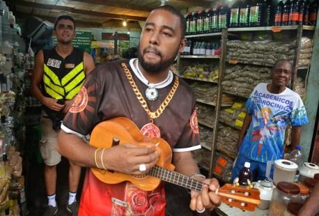 A shopkeeper entertaining us at Rocinha favela, Rio de Janeiro, Brazil