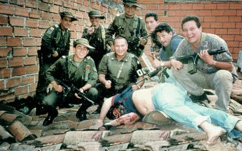 The forces that killed Escobar triumphantly posing over his body. Medellín, Colombia.