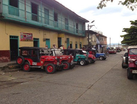 Plaza with jeeps and buses in Quimbaya, Quindío, Colombia