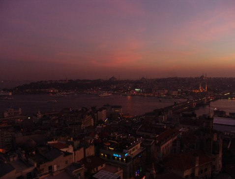 Looking towards the old city at sunset from the top of the Galata Tower in Beyoğlu, Istanbul, Turkey