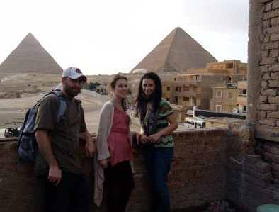 Me, Maria, and Dana posing in front of the pyramids in Giza, Egypt