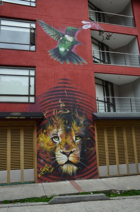 A flaming tiger and hummingbird on the Bogotá Graffiti Tour in Bogotá, Colombia