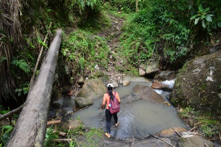 Crossing a creek at Tierradentro, Cauca, Colombia