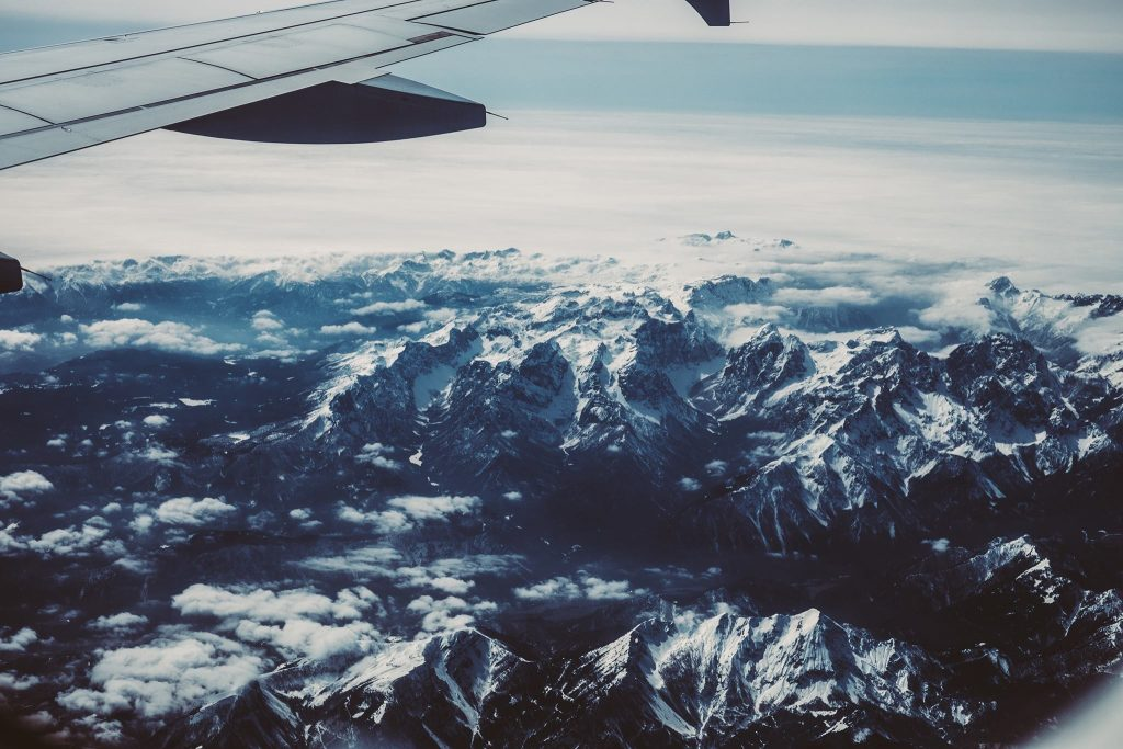 flying-over-snowcapped-mountains