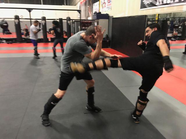 nomad-krav-maga-las-vegas-fighting-sparring-kick-defense