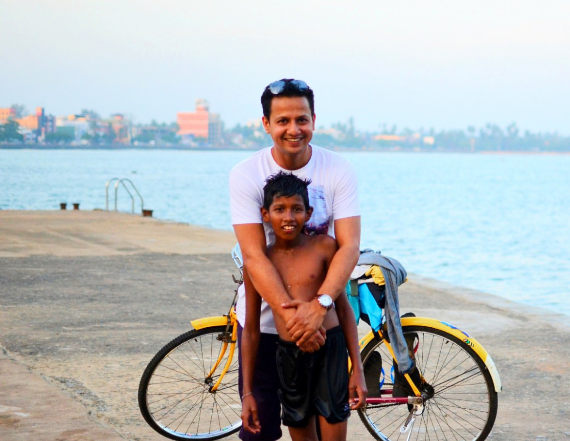 Me with the Kid - who was kind enough to allow us to use his Bicycle