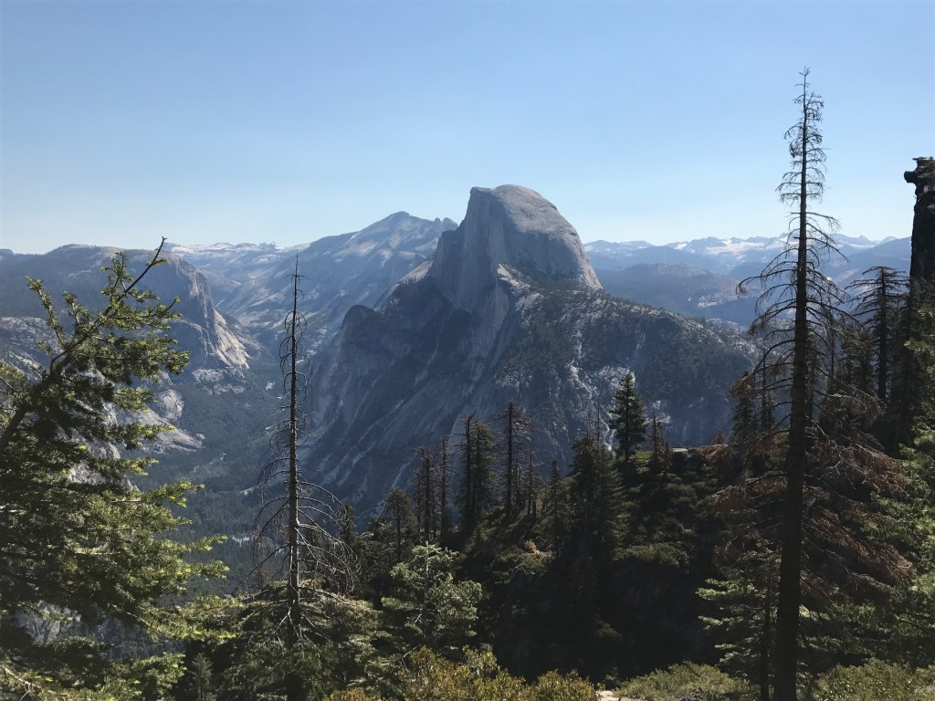 view of half dome while hiking Yosemite valley on our summer adventure road trip