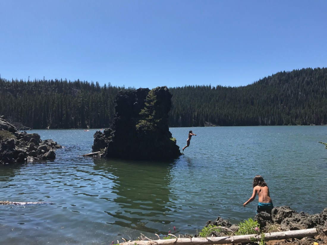 Jumping into Sparks Lake on our summer adventure road trip