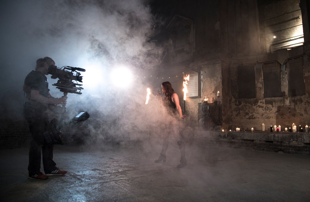 Behind-the-scenes still from a pyrotechnics shoot with fire performer Naomi French