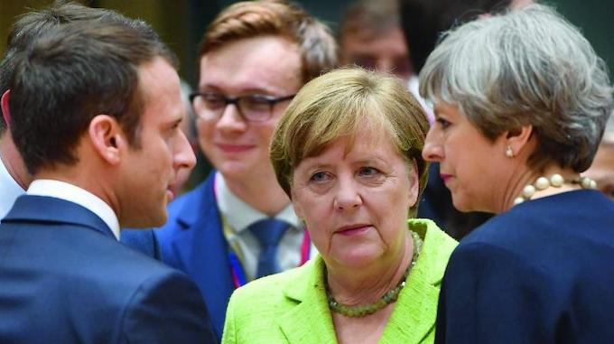 Theresa May Angela Merkel Emmanuel Macron
