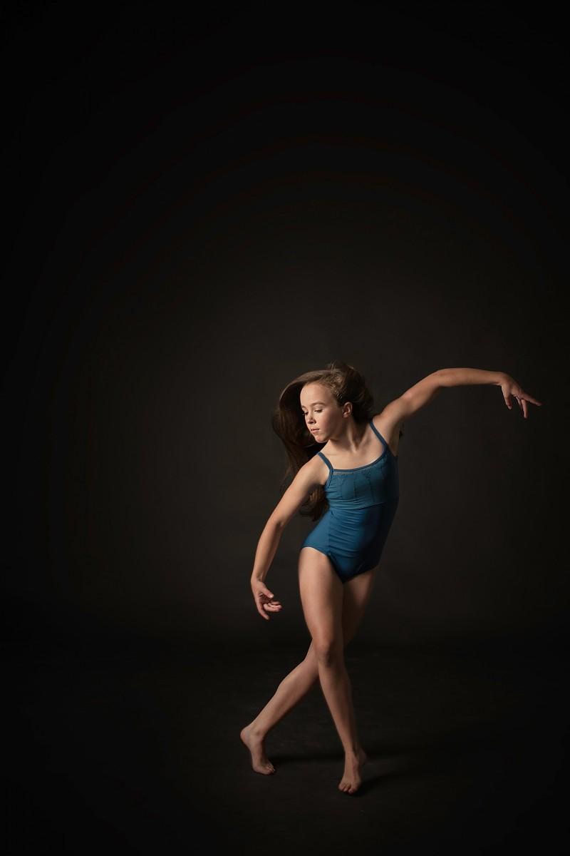 Annsley dancer nomee studio portrait of movement in teal leotard