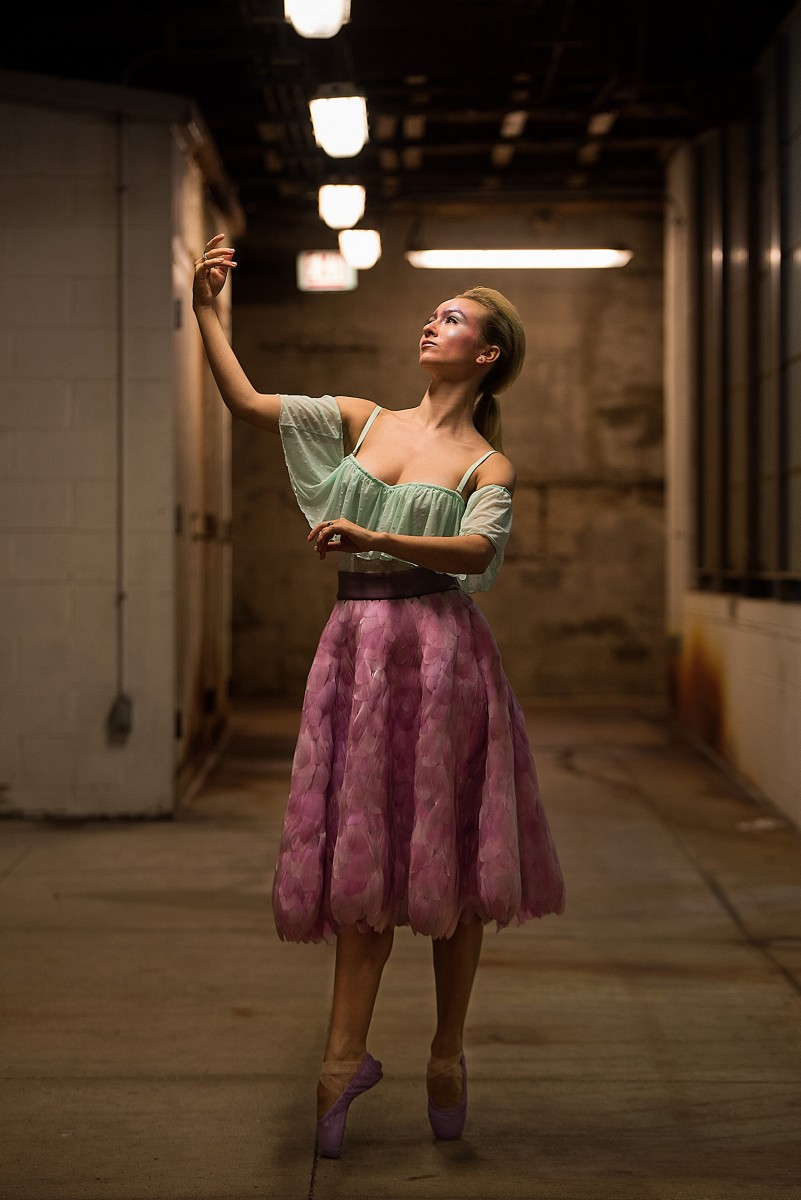 Benita Bunger danish dancer on pointe under Chicago Ave river bridge feather skirt fenty lingerie