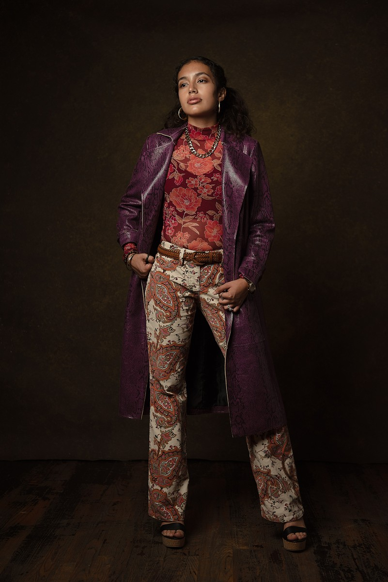 Genesis Martinez Fashion Photoshoot floral attire with purple leather trench