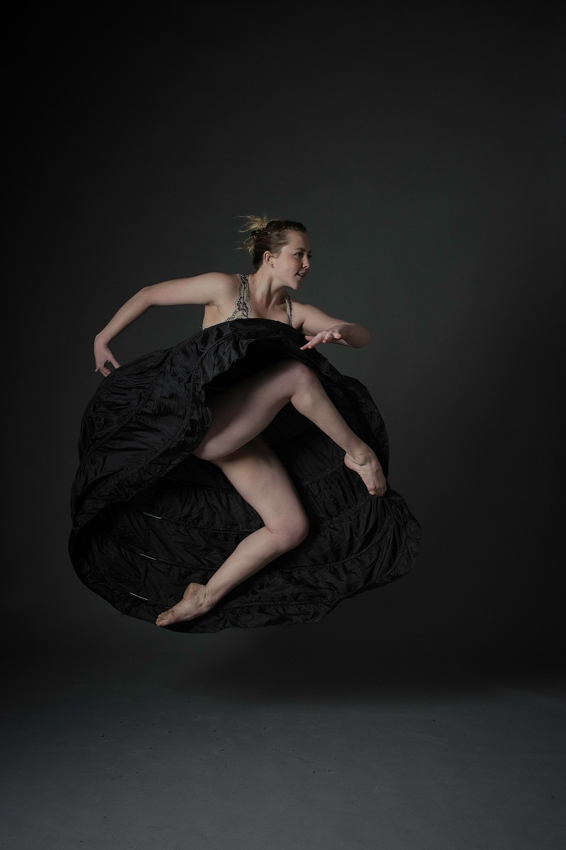 Jess jumping pointed toes in black wired underskirt