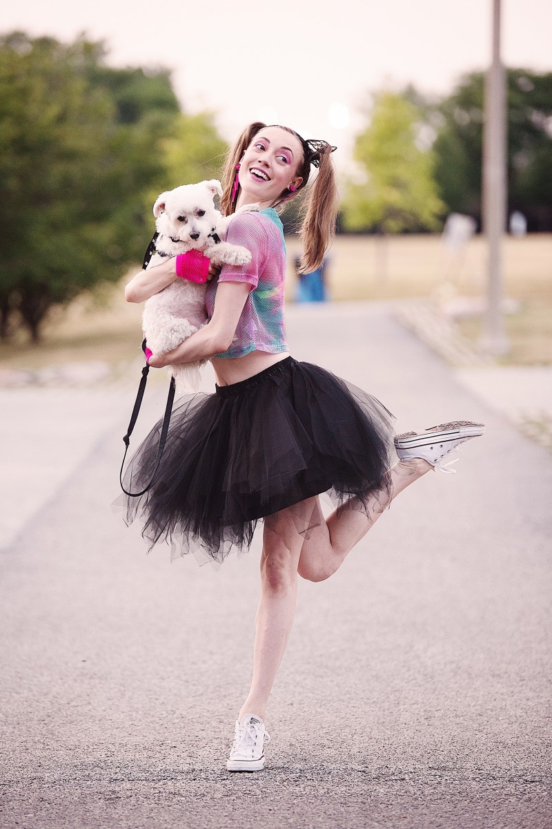Noelle Kayser dancer dressed 80s and pig tails with dog