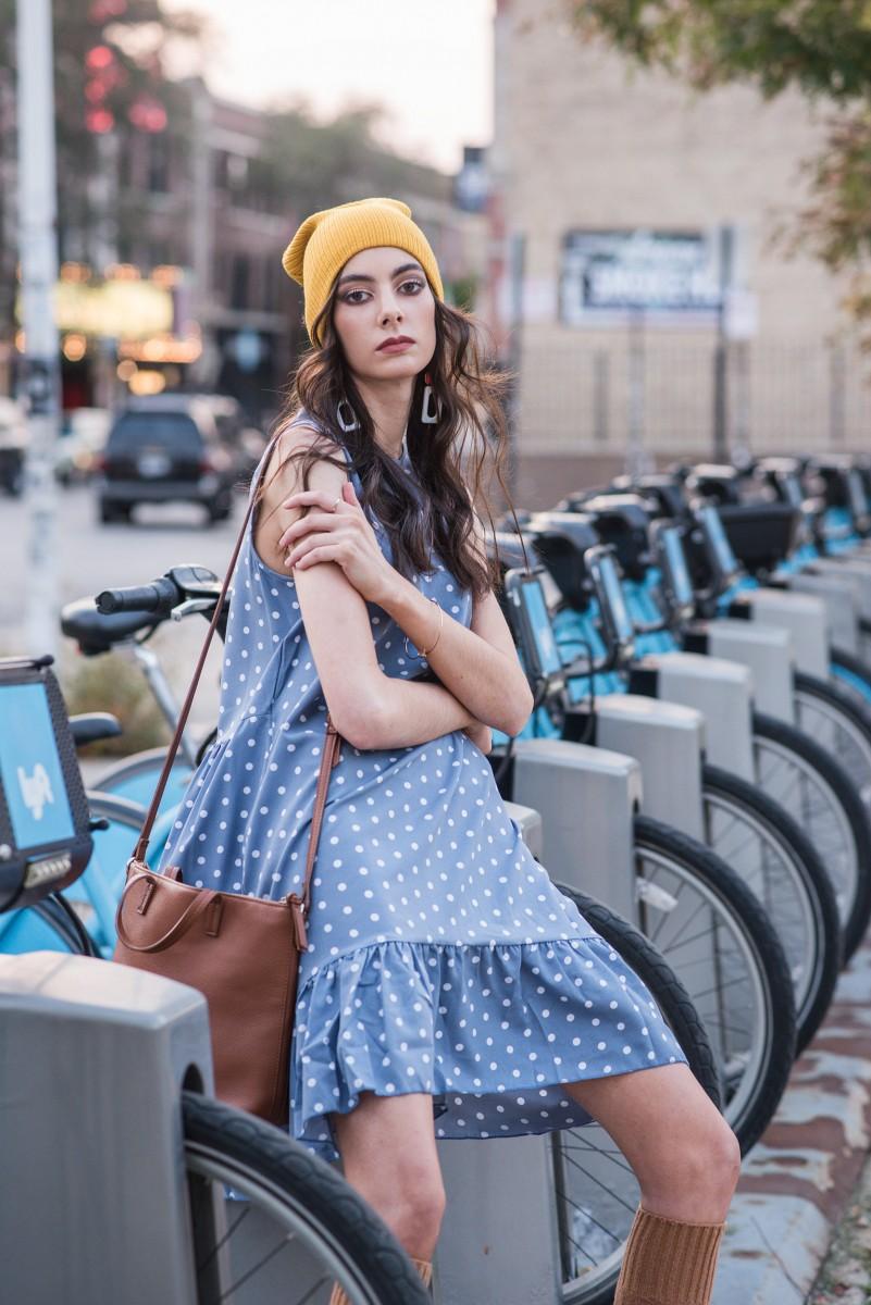 Penelope Bauer Divvy Bikes Chicago Logan Square POkadot Baby doll dress mustard hat and brown satchel