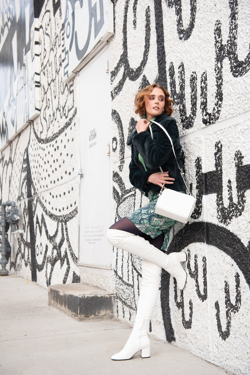 Madelyn Jackson black and white background Green fur coat white boots