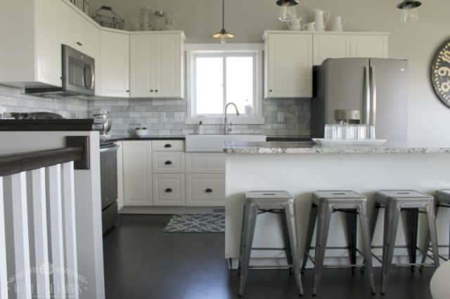 A simple and clean black and white kitchen with rustic and vintage elements.