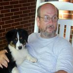 Mystery author Giacomo Giammatteo and his dog Slick