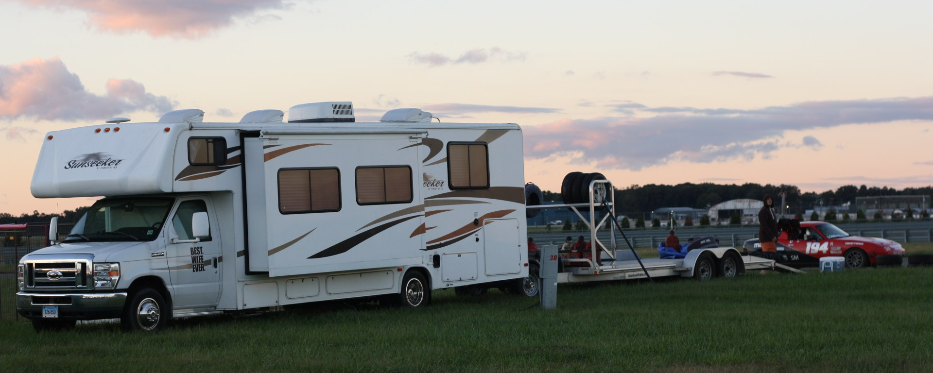 RV with trailer to transport racecar