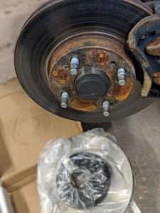 New Brake rotor next to used brake rotor