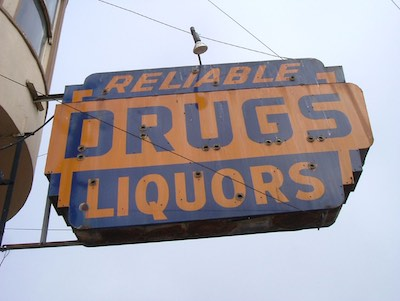 Image of Reliable Drugs Liquors Sign