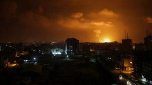 Smoke rises after an Israeli air strike in Gaza City on 15 March 2019
