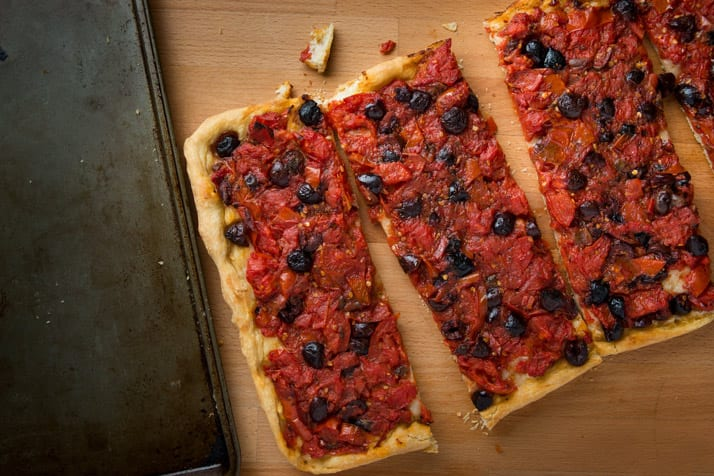 Nonnas Calabrese pizza recipe with tomatoes, kalamata olives, anchovies and hot peppers.